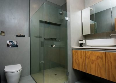 Bathroom design with wall mounted cabinet mirror and a sink with pull-out drawers