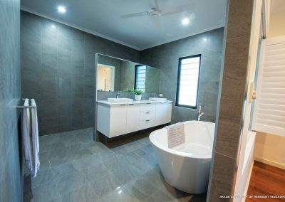 Bathroom with shower area and bathtub