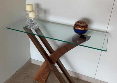 Wooden table with glass top