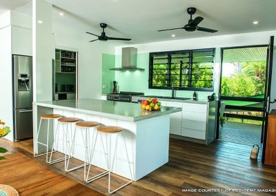 Kitchen Design with built in kitchen tables and chairs | Tropical Renovation
