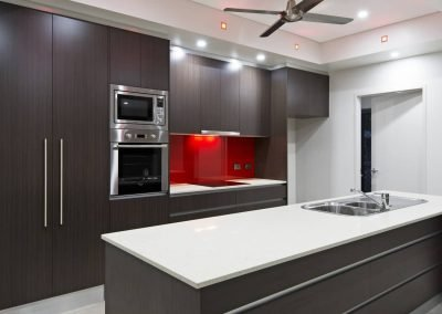 Kitchen with Built in cabinets and a sink at the middle