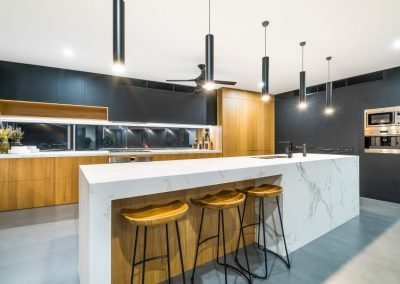 Kitchen with Built in Marble Table and wooden built in cabinet