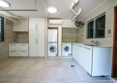Laundry Room With Built-in Cabinet, Sink, and Drawers