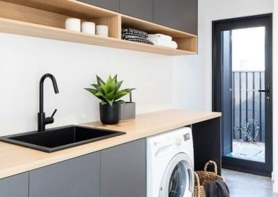 Laundry Area With Wooden Benchtop and Cupboard