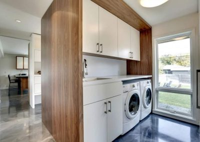 Walk-in Modern Laundry Room with Cabinets