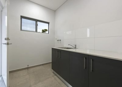 Laundry Area with Benchtop and Cabinets