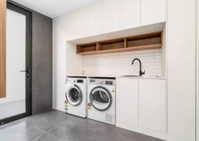 Laundry Area With Cupboard and Sink