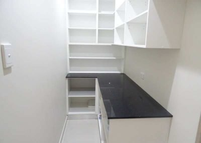 Walk-in Kitch Pantry with Cupboards and Shelves